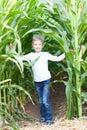 Kid in corn maze Royalty Free Stock Photo