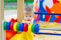 Kid and counting frame cute toddler on the playground playing with colorful Royalty Free Stock Photo