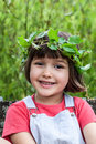 Kid with crown made of ivy leaves looking like an angel smiling Royalty Free Stock Photo