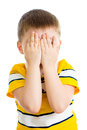 Kid crying or playing with hands hiding face isolated Royalty Free Stock Photos