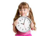 Kid displaying nine o'clock time in studio Royalty Free Stock Photo