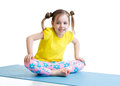Kid does gymnastics sitting in butterfly pose Royalty Free Stock Photo