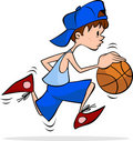 Kid Dribbling the basket ball Royalty Free Stock Photo