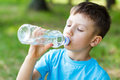 Kid drink water little boy outdoor Royalty Free Stock Photo