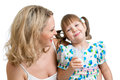 Kid drinking milk. Mother looks to daughter. Stock Image