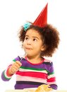 Kid eating birthday cake cute little black three years old girl with fuzzy hair and party hat with spoon isolated on white Stock Photo