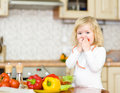 Kid eating healthy vegetables meal in the kitchen Stock Images