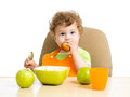 Kid eating by himself baby boy Stock Photos
