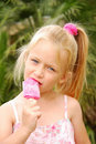 Kid eating ice-cream Stock Images