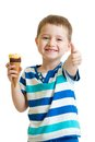 Kid eating ice cream and showing okay sign Royalty Free Stock Photo