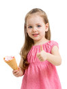 Kid eating ice cream and showing thumb up Royalty Free Stock Photo