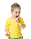 Kid eating and licking ice cream isolated Royalty Free Stock Photo