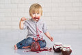 Kid eating strawberry jam cute little boy got messy from glass jars Stock Photo