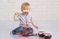 Kid eating strawberry jam Royalty Free Stock Photo