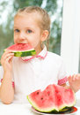Kid eating watermelon portrait of a cute little girl Stock Images