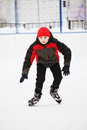 Kid enjoying skating on the ice rink outdoors Royalty Free Stock Photography