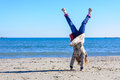 Kid equilibrium on beach Royalty Free Stock Photo