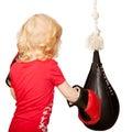 Photo : Kid exercising punching bag   press