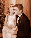 Kid with father near christmas tree child receiving black and white retro Stock Photos
