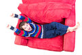 Kid feeling cheerful eight years old promoting a of cheer on the red couch isolated on white Stock Image