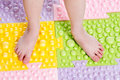 Kid feet on massaging mat child Stock Photography