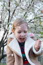 Kid and flower, and strong laughs Royalty Free Stock Photo