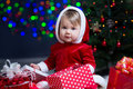 Kid girl at Christmas tree with gifts Royalty Free Stock Photo