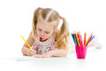 Kid girl drawing with colourful pencils Stock Images