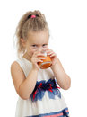 Kid girl drinking juice isolated on white Stock Photos
