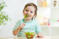 Kid girl eating healthy vegetables Royalty Free Stock Photo