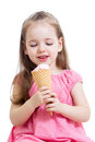 Kid girl eating ice cream joyful child in studio isolated Stock Photos