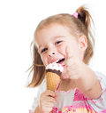 Kid girl eating ice cream and showing thumb up Royalty Free Stock Photo
