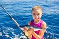 Kid girl fishing tuna bonito sarda fish happy with catch Royalty Free Stock Photo
