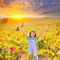 Kid girl in happy autumn vineyard field open arms red grapes bun Royalty Free Stock Photo
