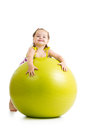 Kid girl having fun with gymnastic ball fitness Stock Image