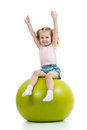 Kid girl having fun gymnastic ball isolated Stock Image