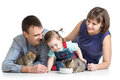 Kid girl and her parents feeding cats kittens Royalty Free Stock Photo
