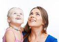 Kid girl isolated portrait with young mother on white look up Stock Photo