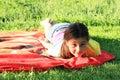 Kid - girl lying on towel Royalty Free Stock Photo