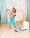 Kid girl with mop cleaning room Stock Images