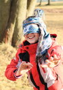 Kid girl playing blind man s buff young in winter clothes smiling happy a game Stock Photos