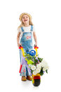 Kid girl with potted flowers and gardening equipment