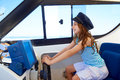 Kid girl pretending be a captain sailor cap in boat Royalty Free Stock Photo