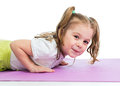 Kid girl pushing up on mat Stock Photos