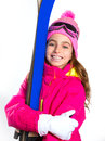 Kid girl ski with snow equipment goggles and winter hat Royalty Free Stock Image