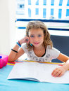 Kid girl smiling with homework in summer Stock Photos