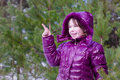 Kid girl surprised pointing finger pine forest Royalty Free Stock Photo