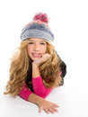 Kid girl with winter wool cap smiling on white Royalty Free Stock Image