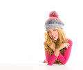 Kid girl with winter wool cap smiling on white Stock Photo