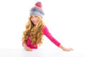 Kid girl with winter wool cap smiling on white Stock Photos